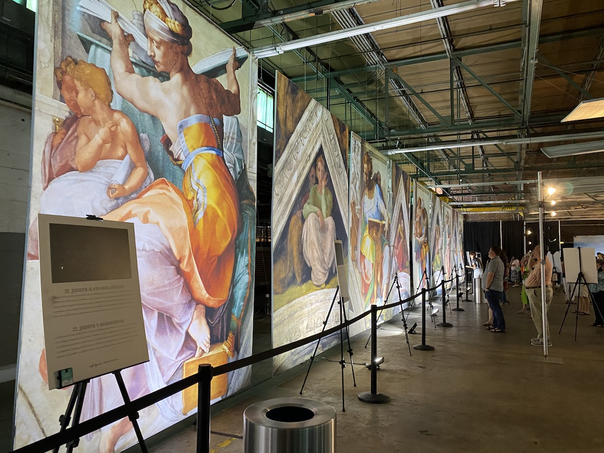 The Creation of Adam welcomes visitors to Michelangelo's Sistine Chapel: The Exhibition presents the master's works at eye level