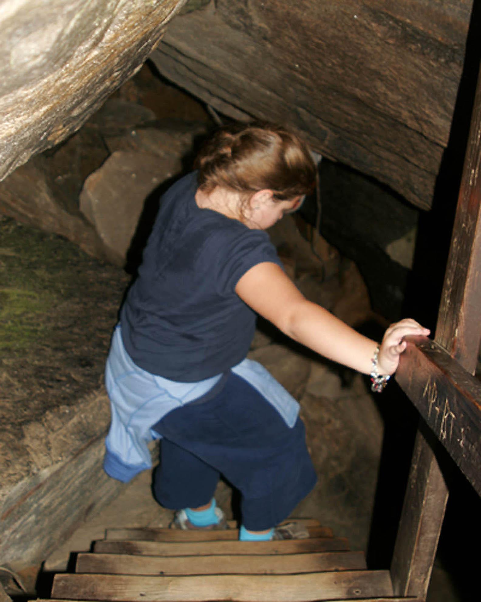 A visitor descends into the Polar Caves